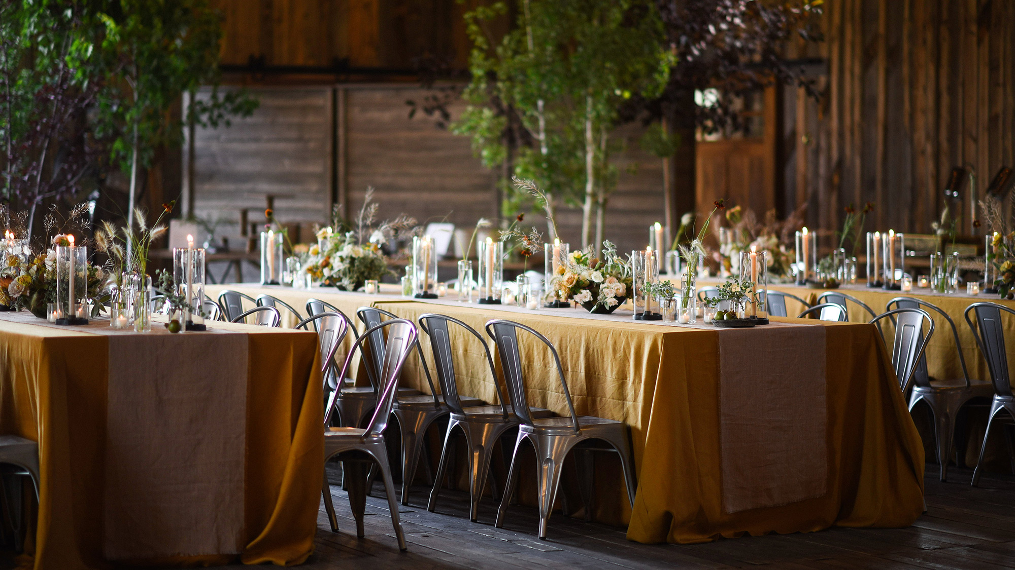 long wedding tables and chairs with flora decorations
