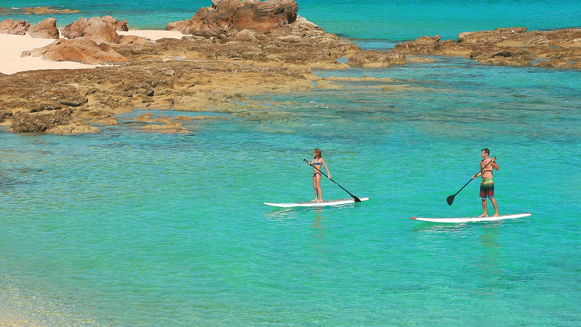 paddleboarding in ocean