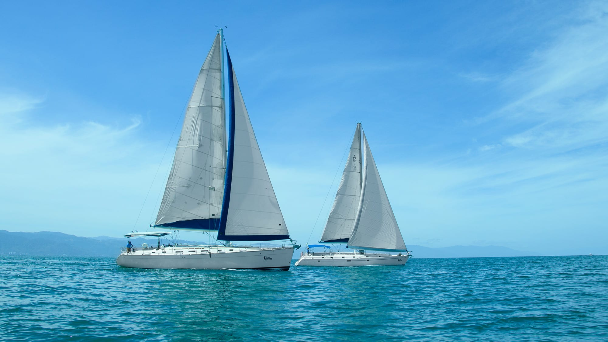 two sailboats on blue water